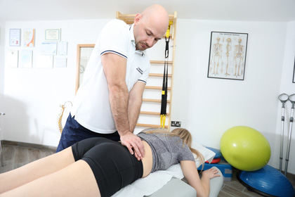 physiotherapist applaying manual therapy on lady